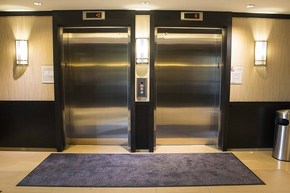 Rismat FloorGuard Magic Mat in front of Elevator